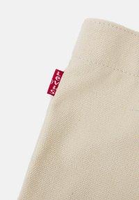 Levi's® - WOMENS SEASONAL BATWING TOTE - Tote bag - ecru - 4