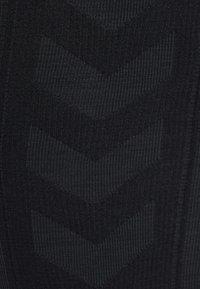 Hummel - HMLCLEA - Leggings - black melange - 14