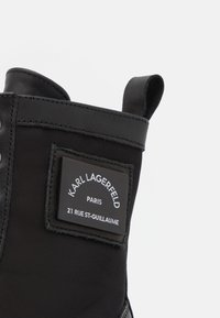 KARL LAGERFELD - TERRA FIRMA HI LACE BOOT - Platform ankle boots - black - 6