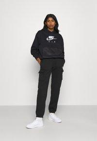 Nike Sportswear - AIR HOODIE - Hoodie - black/white - 1