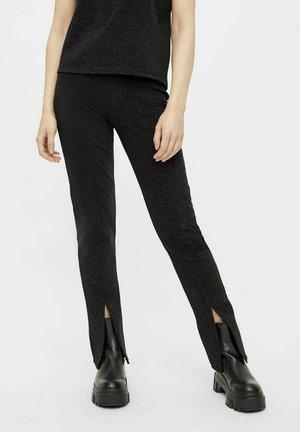 GESCHLITZTE GLITZER - Trousers - black