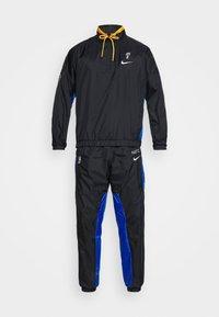 Nike Performance - NBA BROOKLYN NETS CITY EDITION TRACKSUIT - Tracksuit - black/royal blue/university gold - 7