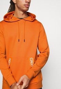 Calvin Klein Performance - HOODIE - Huppari - orange - 4