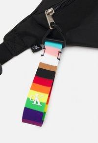 Calvin Klein Jeans - PRIDE WAISTBAG UNISEX - Bum bag - black - 3