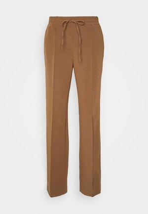 MONI - Trousers - peanut