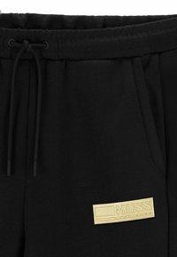 BOSS - HEADLO BATCH Z - Pantalon de survêtement - black - 5