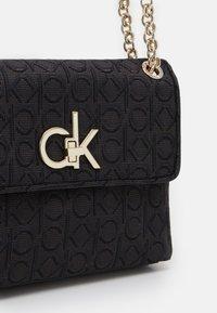 Calvin Klein - RE LOCK CROSSBODY - Torba na ramię - black - 3