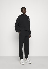 Stieglitz - Teplákové kalhoty - black - 1