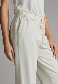 Massimo Dutti - Tracksuit bottoms - white - 3