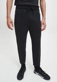 Calvin Klein - Pantaloni sportivi - ck black - 0