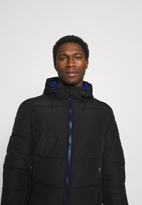 Superdry - SPORTS PUFFER - Winter jacket - black - 4