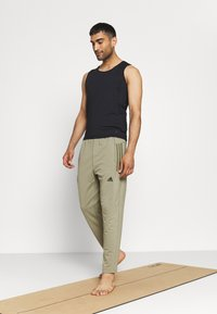 adidas Performance - MENS YOGA PANT - Tracksuit bottoms - orbit green - 1