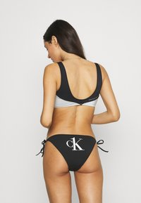 Calvin Klein Swimwear - STRING SIDE TIE - Bikini bottoms - black - 2
