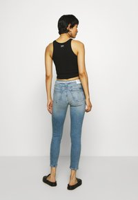 Calvin Klein Jeans - MID RISE SKINNY ANKLE - Jeans Skinny Fit - light blue - 2