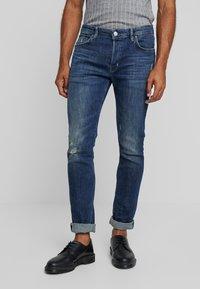 AllSaints - CIGARETTE DAMAGED - Slim fit jeans - indigo - 0