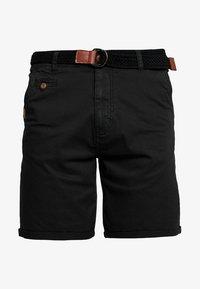 CONER - Shorts - black