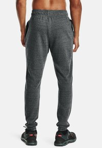 Under Armour - RIVAL TERRY  - Tracksuit bottoms - pitch gray full heather