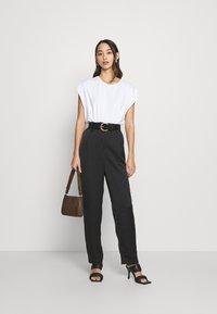 Monki - LAINEY TROUSERS - Trousers - black - 1