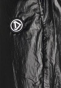 Diesel - P-TOLLER-RIP - Trousers - black - 2