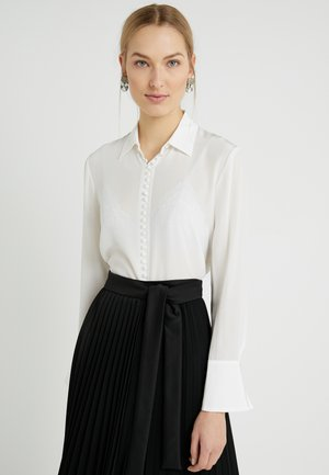 HELEK - Button-down blouse - blanc