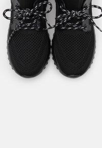 Calvin Klein Jeans - RONETTE - Trainers - black/silver - 5