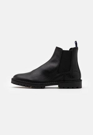 CALVIN - Korte laarzen - black