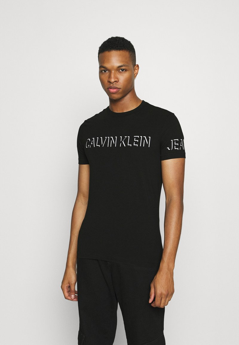 Calvin Klein Jeans - SHADOW LOGO TEE - T-shirt con stampa - black