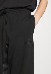 adidas Originals - R.Y.V. SWEATPNT ORIGINALS PANTS - Tracksuit bottoms - black - 3