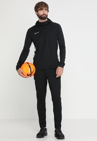 Nike Performance - DRY ACADEMY - Tracksuit bottoms - black/white - 1