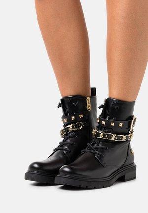 BY GUIDO MARIA KRETSCHMER - Cowboy/biker ankle boot - black/gold