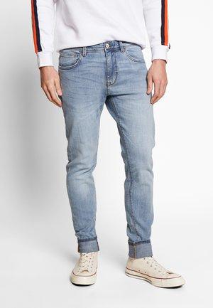 ROSKLAIR - Slim fit jeans - bleached
