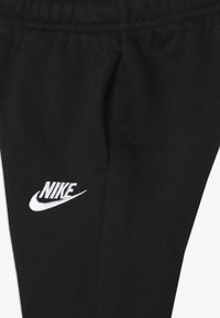 Nike Sportswear - CLUB CUFF PANT - Tracksuit bottoms - black - 3