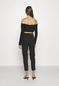 Levi's® - HIGH WAISTED TAPER - Jeans relaxed fit - flash back