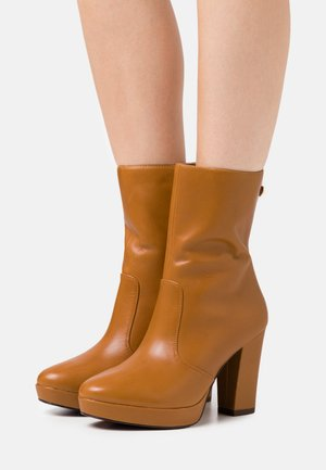 BOOTS  - High heeled ankle boots - mustard