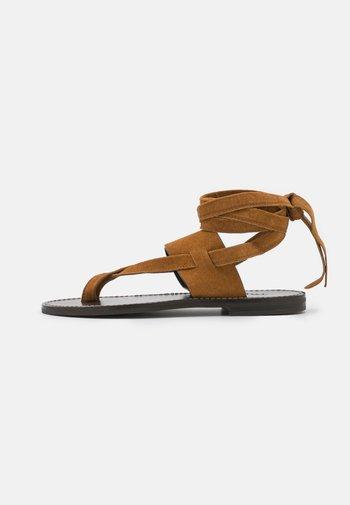T-bar sandals - sigaro