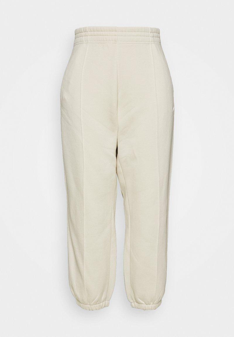 Nike Sportswear - PANT TREND PLUS - Tracksuit bottoms - coconut milk