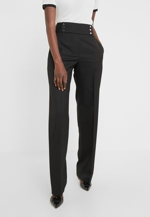 HADINA - Trousers - black