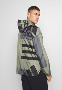 adidas Performance - URBAN ALLOVER PRINT WIND.RDY  - Outdoor jacket - green - 2