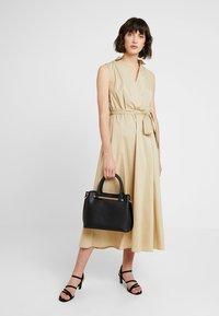 Dorothy Perkins - BAR MINI TOTE - Handbag - black - 1