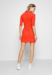 J.LINDEBERG - SAHRA LUX SCULPT - Sportovní šaty - tomato red - 2