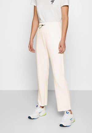 SOFT INTERLOCK - Tracksuit bottoms - offwhite