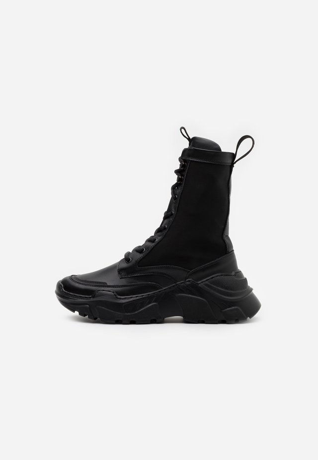 REFERENCE BOOT - Platform ankle boots - black