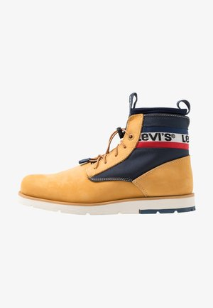 JAX LITE SPORTSWEAR - Bottines à lacets - regular yellow
