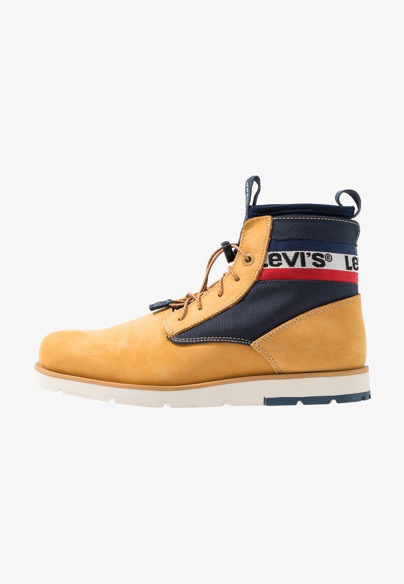Levi's® - JAX LITE SPORTSWEAR - Botines con cordones - regular yellow