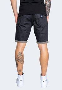Calvin Klein Jeans - Denim shorts - black - 2