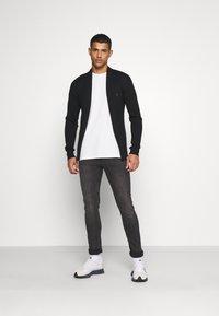 AllSaints - CIGARETTE - Jeans Skinny Fit - washed black - 1