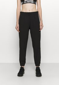 DKNY - RELAXED - Tracksuit bottoms - black - 0