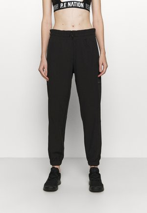 RELAXED - Tracksuit bottoms - black