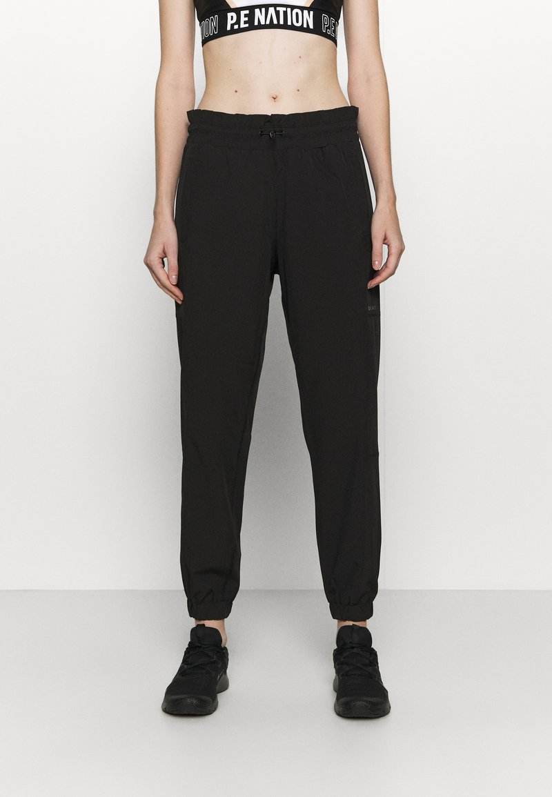 DKNY - RELAXED - Tracksuit bottoms - black