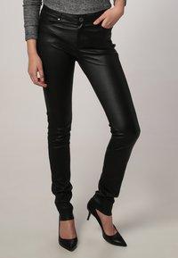 Oakwood - P ANDORA - Leather trousers - black - 0